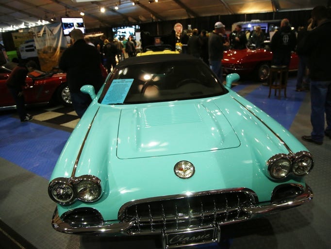 A 1958 CRC Retro Vette in teal shows off on the final
