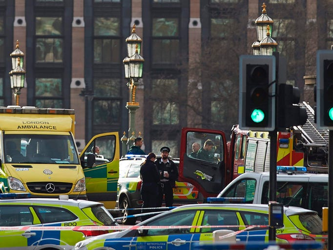 Members of the emergency services work on Westminster
