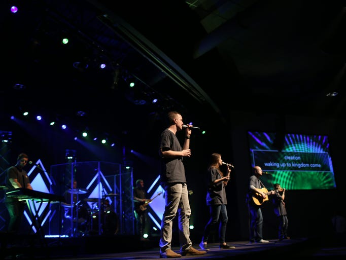 The worship team leads the congregation in song at