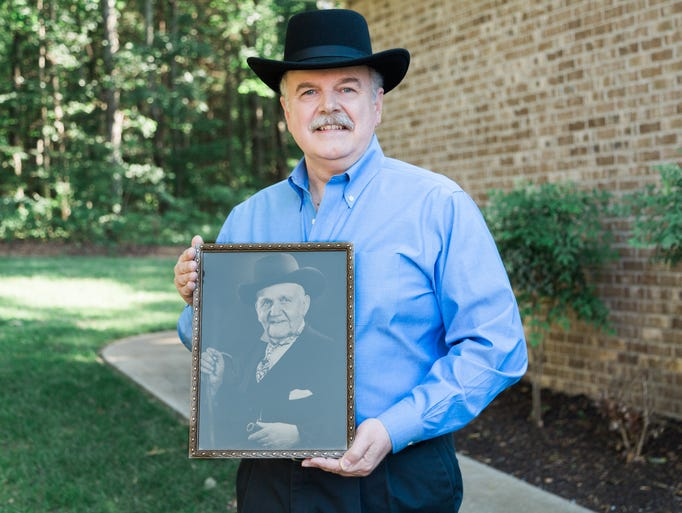 Michael Doubler holds a portrait of his great-grand