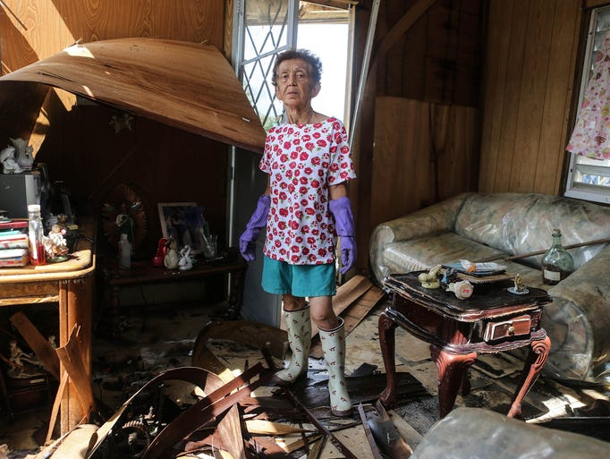 Sonia Torres, 60, poses in her destroyed home while