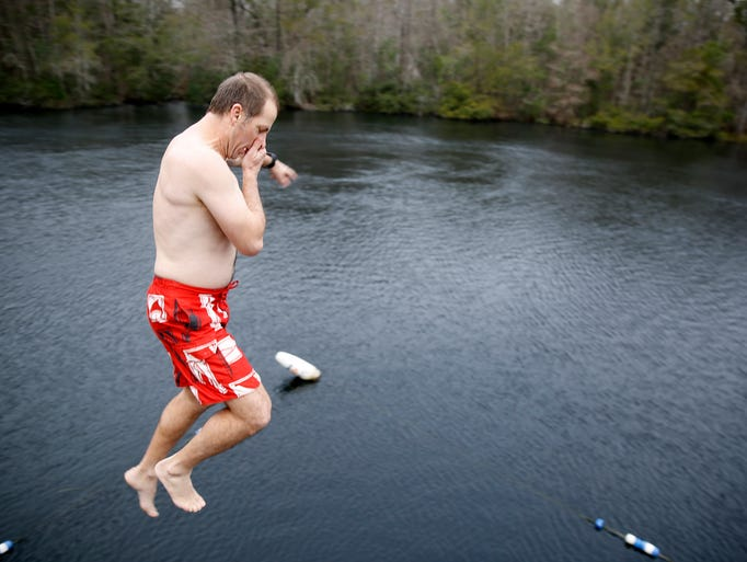 """Jim Smart takes the """"polar plunge"""" off the high dive"""