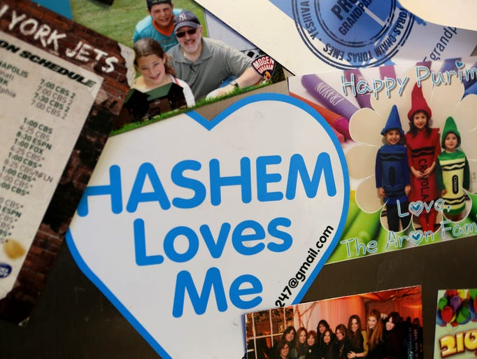 "A ""Hashem Loves Me"" sticker hangs on the refridgerator"