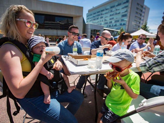 Joben Levenhagen, 3, right, enjoys pizza with Samantha