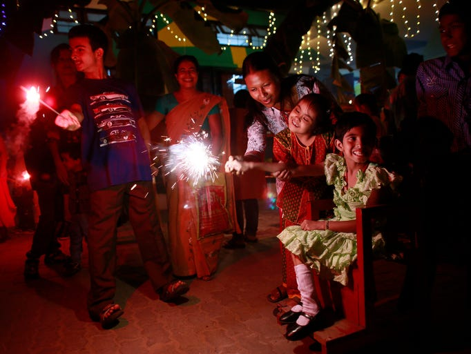 Children with special needs light firecrackers as they