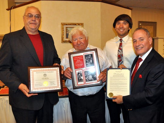 Ernie Marcacci, one of the founding members of the city of Vineland's Mini-Wrestling program, was given the first Lifetime Achievement Award at the VHS All-Sports banquet on June 2. He was also a member of the city's recreation commission for 38 years and chairman for the past 25 years. From left: Eugene Medio, Marcacci, VHS crew member Josh Marcacci and Mayor Ruben Bermudez.