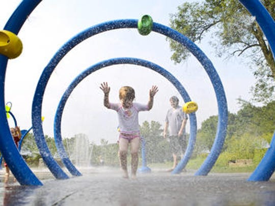 Penelope Curley walks through the Sprayground at the Beckley Creek Park, part of the 21st Century Parks off Beckley Station Road.