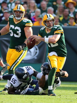 Packers quarterback Aaron Rodgers is sacked against the Seahawks.