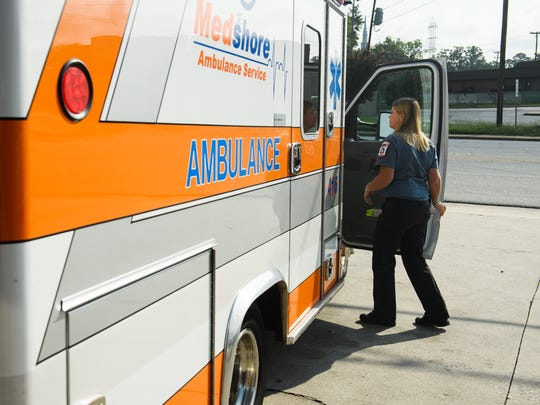 Leslie Green, 31, an EMT with MedShore, closes the door on her truck during a shift in anderson on Thursday, July 31, 2018.