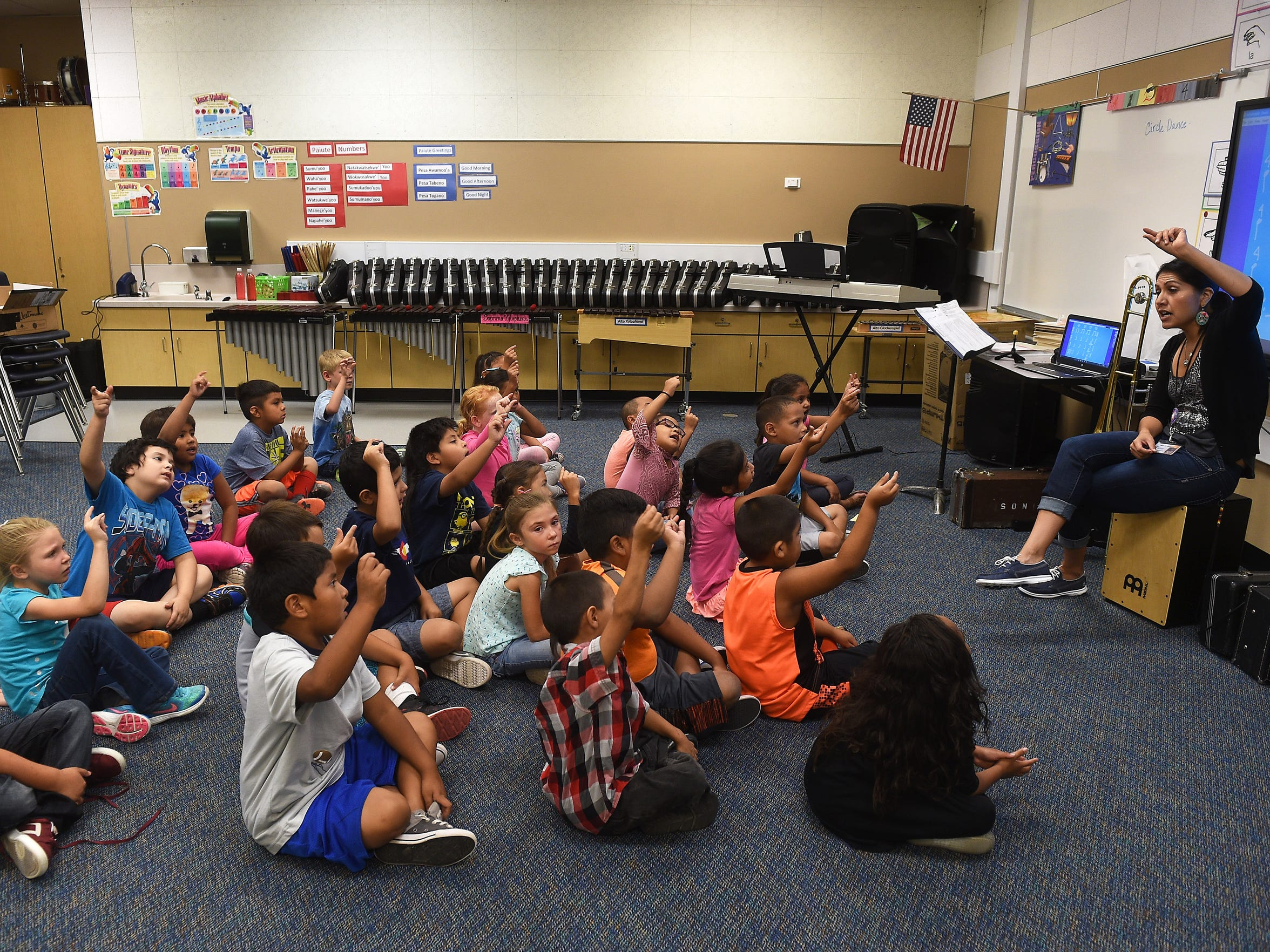 Music teacher Michelle McCauley conducts a class at