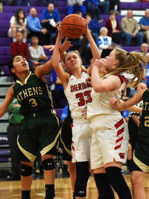 Emma Conrad pulls down a rebound during the first half of Sheridan's 62-26 win against Athens in a Division II sectional game on Thursday night in Logan.