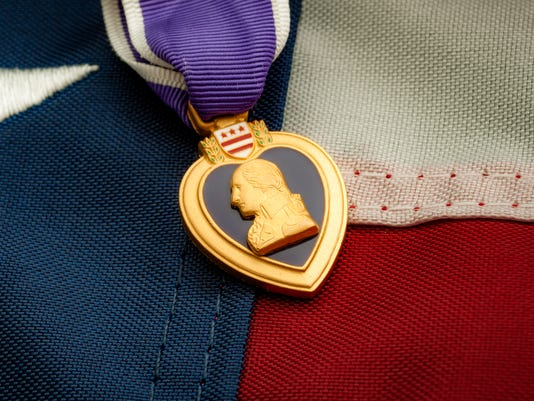 The Purple Heart and the American flag