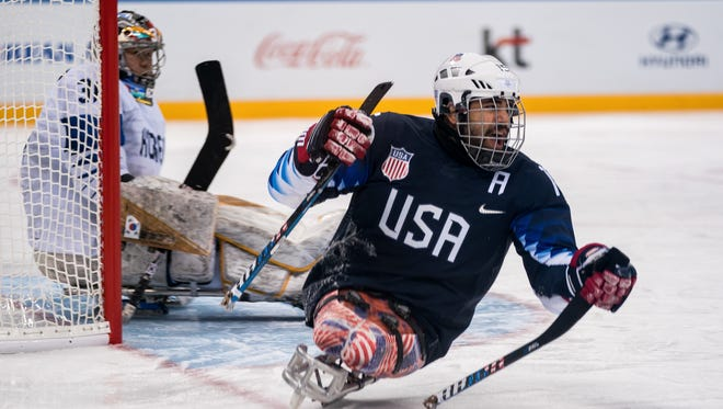 Nikko Landeros of the U.S. looks for a pass during a Paralympic Winter Games  preliminary round game between the U.S. and Korea at the Gangneung Hockey Centre. The Paralympic Winter Games in PyeongChang, South Korea on Tuesday. Landeros lives in Johnstown.