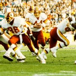 Washington Redskins guard Fred Dean in action as Joe Theismann looks to pass against the Miami Dolphins during Super Bowl XVII at the Rose Bowl. The Redskins defeated the Dolphins 27-17 in January 1983.