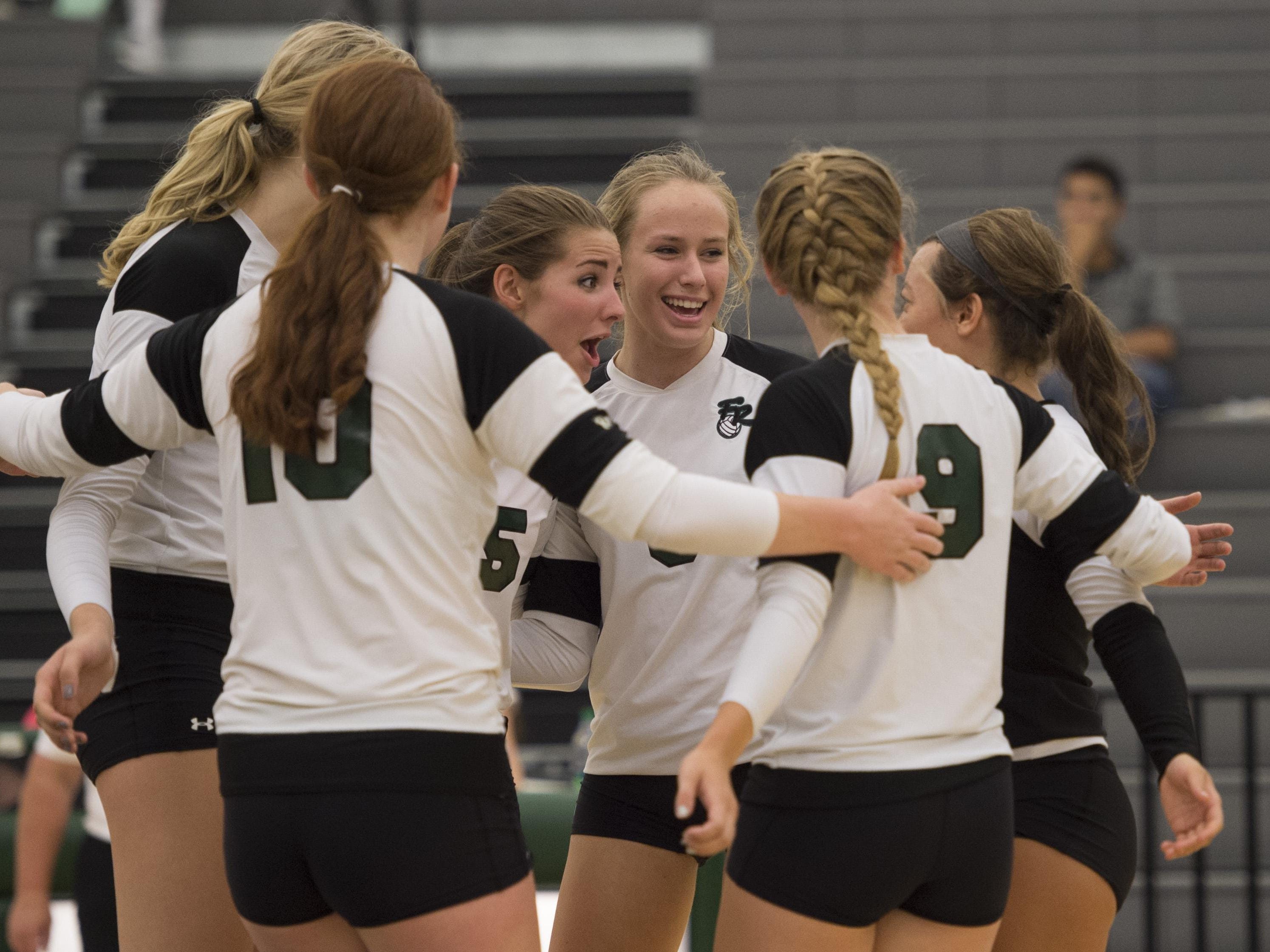 The Fossil Ridge volleyball team, shown in a game earlier this season, moved to 8-3 with a road win at Monarch on Wednesday.
