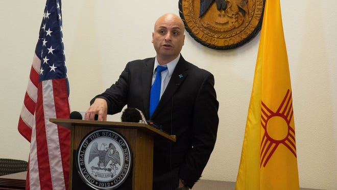 Hector Balderas, the New Mexico Attorney General, announced the AG's office was opening an investigation into Big Agriculture in harming New Mexico Consumers and Family Businesses in a press conference, Tuesday, April 25, 2017 in the District Attorney's office.