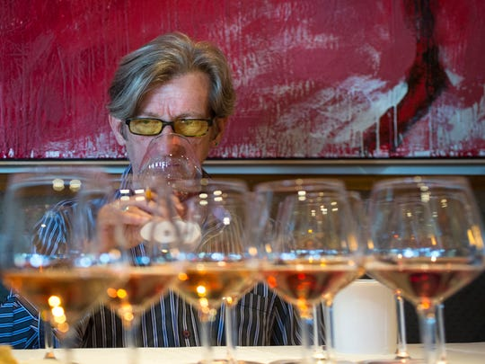 Richard Betts, with Napa Exclusives, samples a rose (accent above the e) at The Arizona Republic Wine Competition at Tarbell's in Phoenix, on Monday, October 27, 2014. Twenty judges each graded 30 wines in the preliminary round, with around 140 Arizona wines competing for top honors.