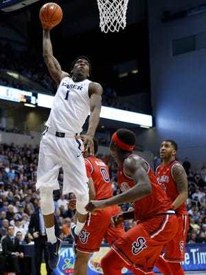 Xavier Musketeers forward Jalen Reynolds (1) dunks during the second half against the St. John's Red Storm at the Cintas Center. Xavier 90-83.