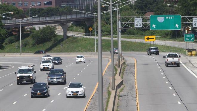 Traffic heads east on Interstate 490 near Alexander Street in Rochester, N.Y., on July 22, 2014.