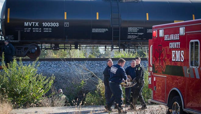 Emergency responders transport the victims of a pedestrian-train accident near Bunch Boulevard and Jackson Street on Saturday, Oct. 17, 2015.