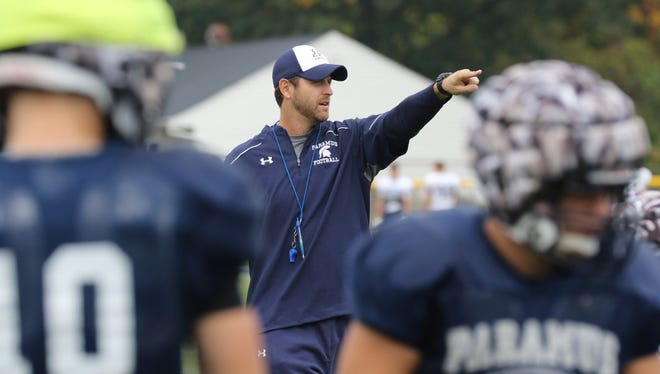 Bill Weigel works with his Paramus HS football team in October.