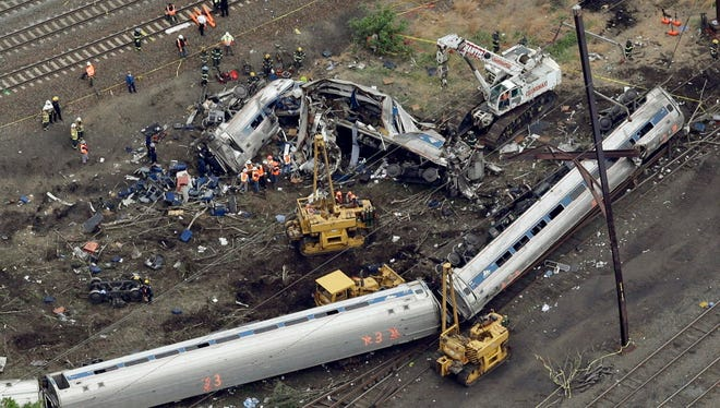 Emergency personnel work May 13, 2015, at the scene of a derailment in Philadelphia of an Amtrak train headed to New York.