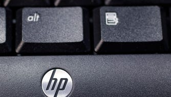This Nov. 14, 2011 photo, shows the company logo on a Hewlett-Packard keyboard at the Micro Center computer store in Santa Clara, Calif.