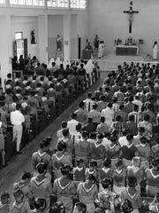 In this August 1965 photo, dozens of Boy Scouts attend Mass at the Our Lady of Mount Carmel Church in Agat. In Guam, there was a strong connection between the Catholic Church and the Boy Scouts.