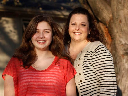 Heather Tucker, right, is a single parent to her daughter, Faith, 13. She was 25 and married when Faith was