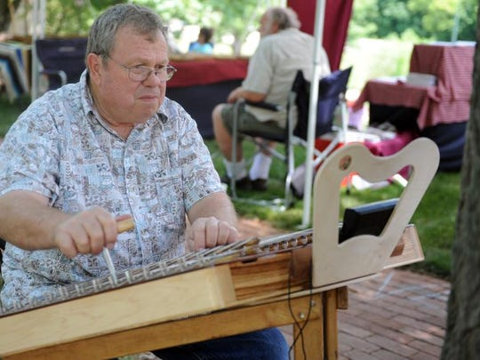 David Lindsey of Bennington, Oklahoma, tunes his dulcimer in this Tribune file photo. He will be one of the many instructors offering workshops during Coshocton Dulcimer Days this weekend in Roscoe Village.