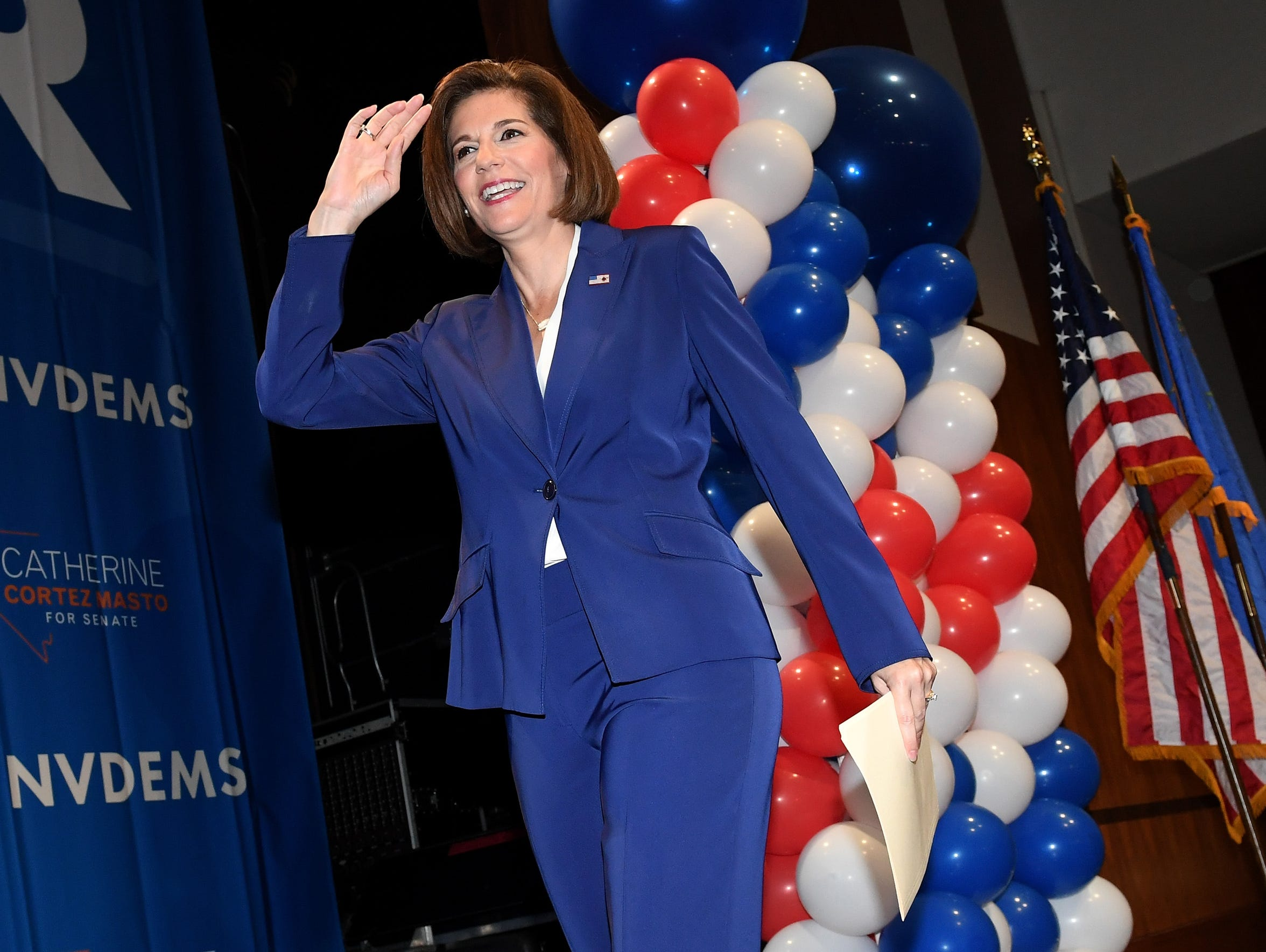 Catherine Cortez Masto walks on stage in Las Vegas