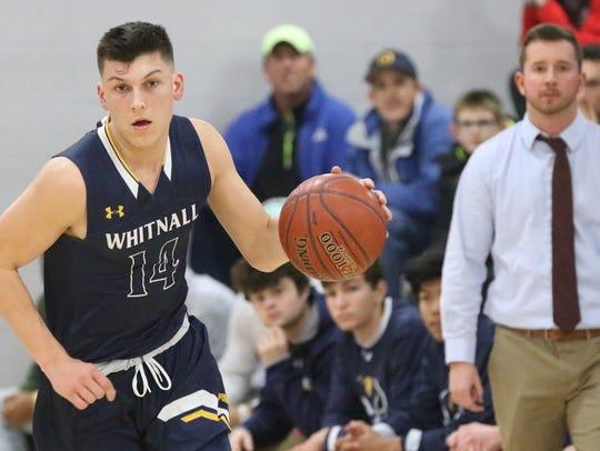Whitnall's Tyler Herro brings the ball upcourt at Shorewood