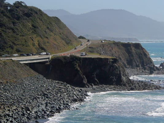AP SUV OFF CLIFF A USA CA