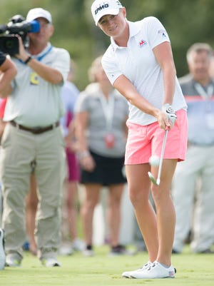 Stacy Lewis hits a golf ball at a target in a tire during the Yokohama Tire LPGA Classic Champions Challenge on Tuesday, Sept. 16, 2014 at Robert Trent Jones Golf Trail at Capital Hill in Prattville, Ala.