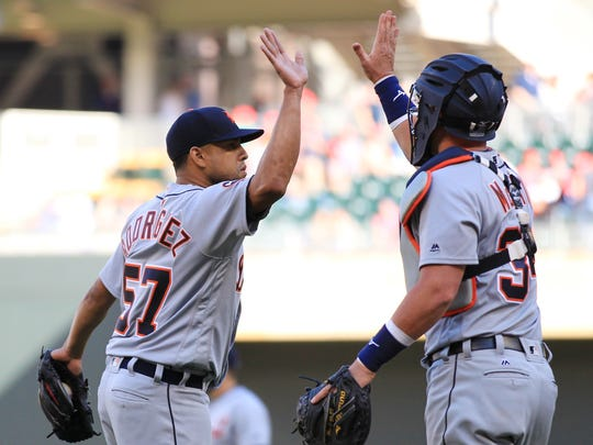 Francisco Rodriquez celebrates with catcher James McCann