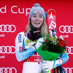 Mikaela Shiffrin celebrates on the podium after winning the women's slalom race in the FIS alpine skiing World Cup at Aspen Snowmass.