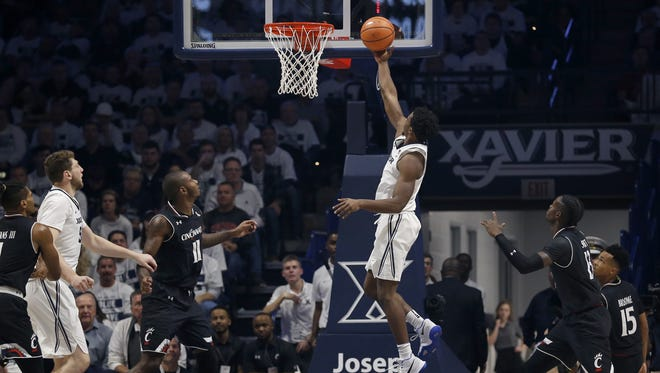 Xavier guard Quentin Goodin (3) tosses in a layup in the second half against UC.
