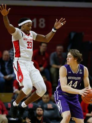 Rutgers forward Deshawn Freeman (33) defends Northwestern Wildcats forward Gavin Skelly (44).