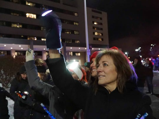 Crowds wave flashlights to the patients on the pediatric