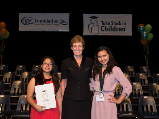 Ann Decker, executive director of the IRSC Foundation with scholars sponsored by IRSC employees, Itzel Martinez and Stephanie Vega