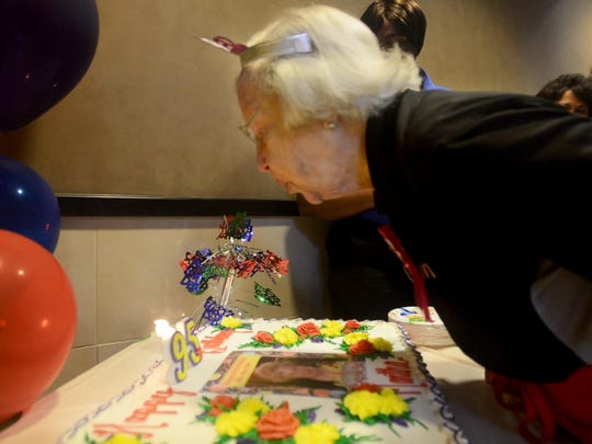 Martha Reves blows out candles Tuesday during her 95th birthday at McDonald's on North Highland Avenue. Reves has been employeed at McDonald's for over 20 years.