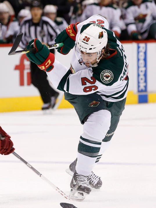 FILE - In this March 29, 2014 file photo, Minnesota Wild's Matt Moulson (26) follows through on a shot against the Phoenix Coyotes during the first period of an NHL hockey game in Glendale, Ariz. NHL teams can begin making deals with free agents Tuesday, July 1, 2014. (AP Photo/Ross D. Franklin, File)