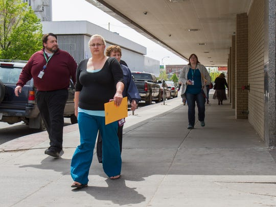 Asurion employees leave the building after learning