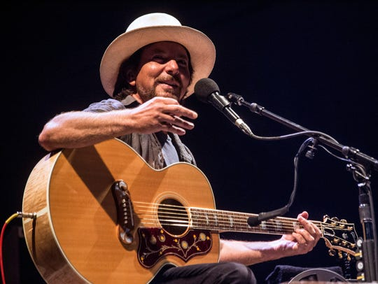 Rock legend Eddie Vedder took to the stage solo for