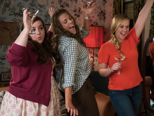 """""""I Feel Pretty"""" star Amy Schumer, right, with her onscreen"""