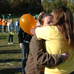 Friends and family remember loved ones who lost the battle over suicide at the 2008 Out of the Darkness event at Glen Miller Park in Richmond.