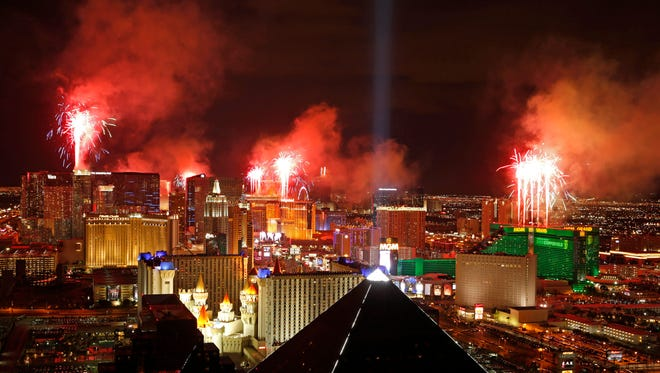 Fireworks explode above the Strip to ring in the new year in Las Vegas, January 1, 2015. There is no legal ban on bags, backpacks and strollers, but police want New Year's Eve revelers in Las Vegas this year to leave them at home or in their hotel rooms.