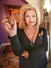 Marilene Isaacs Kauffman holds an egg that reflects the combined forces of fertility, spirituality and power in union with the devine male.