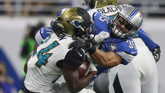 Lions safety Miles Killebrew tackles Jaguars running back T.J. Yeldon on Nov. 20, 2016 at Ford Field in Detroit.