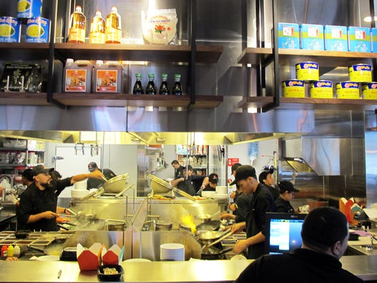 Cooks can clearly be seen wok-firing made-to-order